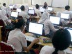 persyaratan penyelenggara ujian nasional berbasis komputer